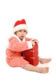 O menino com um presente Imagem de Stock