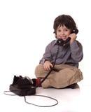O menino com um telefone Imagem de Stock Royalty Free