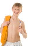 O menino com um tooth-brush imagem de stock