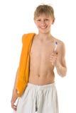 O menino com um tooth-brush Fotografia de Stock Royalty Free