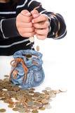 O menino considera o dinheiro Fotografia de Stock Royalty Free