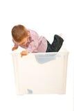 O menino da criança salta em uma caixa Fotografia de Stock Royalty Free