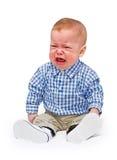 O menino de grito nos rasgos Imagem de Stock Royalty Free