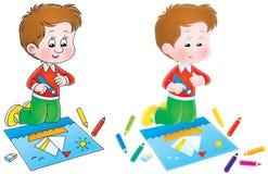 O menino desenha um retrato Foto de Stock Royalty Free