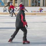 O menino desliza no gelo Imagem de Stock Royalty Free