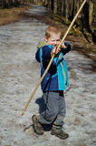 O menino dispara em uma curva Foto de Stock Royalty Free