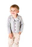 O menino disparou no estúdio em um levantamento branco do fundo Imagem de Stock