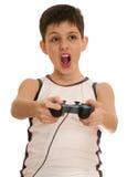O menino do Ardor está jogando um jogo de computador com manche imagem de stock