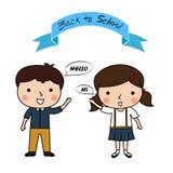O menino e a menina cumprimentam dizem olá!, de volta à escola Fotografia de Stock Royalty Free