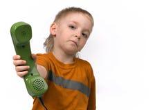 O menino e o telefone Imagem de Stock Royalty Free