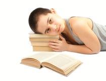 O menino e os livros foto de stock royalty free
