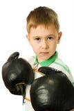 O menino em luvas de encaixotamento Fotografia de Stock