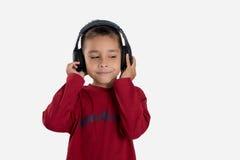 O menino escuta a música Imagens de Stock Royalty Free