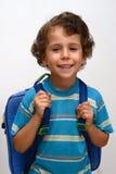 O menino está indo na escola Imagens de Stock