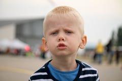 O menino está irritado Imagem de Stock