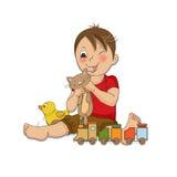 O menino está jogando com seus brinquedos Imagens de Stock