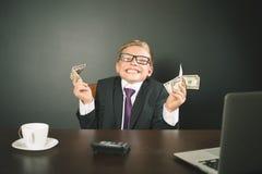 O menino ganhou muito dinheiro Foto de Stock Royalty Free