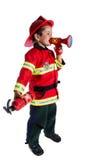 O menino idoso de cinco anos em um sapador-bombeiro do terno diz no orador Fotos de Stock Royalty Free