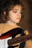 O menino joga a guitarra Fotos de Stock Royalty Free
