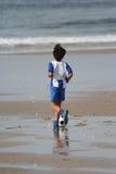 O menino joga o futebol Imagens de Stock Royalty Free