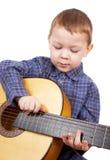 O menino joga uma guitarra Foto de Stock Royalty Free