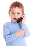O menino no azul fala no telefone. Foto de Stock Royalty Free