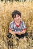 O menino no campo Foto de Stock Royalty Free