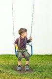 O menino no campo de jogos Fotos de Stock Royalty Free