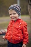 O menino novo de três anos no campo de jogos Foto de Stock Royalty Free