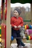 O menino novo de três anos no campo de jogos Imagem de Stock