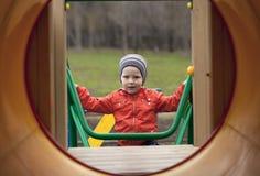 O menino novo de três anos no campo de jogos Imagem de Stock Royalty Free