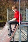 O menino novo toma um descanso Fotos de Stock Royalty Free
