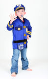 O menino novo vestiu-se acima como um oficial de polícia Foto de Stock