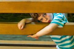 O menino olhou furtivamente Imagem de Stock