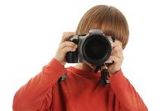 O menino prende uma câmera Imagens de Stock Royalty Free