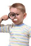 O menino a que tudo é interessante foto de stock royalty free