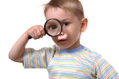 O menino a que tudo é interessante imagens de stock