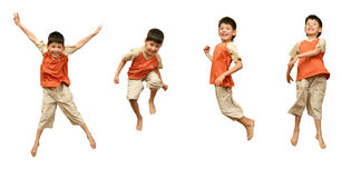 O menino salta no fundo branco. Fotos de Stock Royalty Free