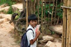 O menino vai à escola para uma lição Fotografia de Stock Royalty Free