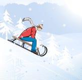 O menino vai para uma movimentação em sledges Foto de Stock Royalty Free