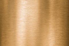 O metal do ouro, do bronze ou do cobre escovou a textura fotografia de stock