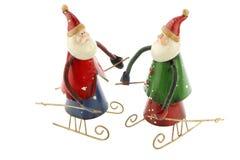 O metal velho Santa Claus do vintage figura em um trenó Fotografia de Stock Royalty Free