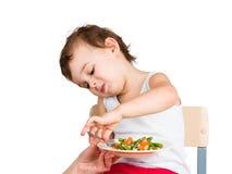 O miúdo não quer comer Imagem de Stock