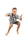 O miúdo que salta para a alegria Imagens de Stock