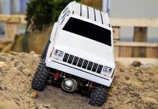 O modelo do carro mostra fora para corridas da demonstração na areia Imagem de Stock