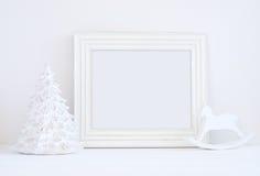 O modelo do Natal denominou a fotografia conservada em estoque com quadro branco Foto de Stock
