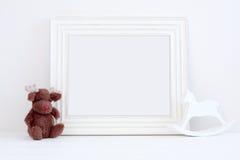 O modelo do Natal denominou a fotografia conservada em estoque com quadro branco Imagens de Stock Royalty Free