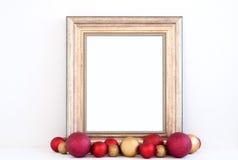O modelo do Natal denominou a fotografia conservada em estoque com quadro do ouro Fotografia de Stock Royalty Free
