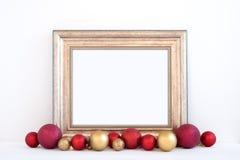 O modelo do Natal denominou a fotografia conservada em estoque com quadro do ouro Foto de Stock