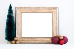 O modelo do Natal denominou a fotografia conservada em estoque com quadro do ouro Fotos de Stock Royalty Free